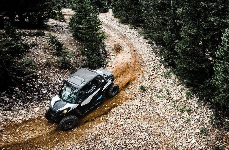 2019 Can-Am Maverick™ Trail 1000 driving on a trail