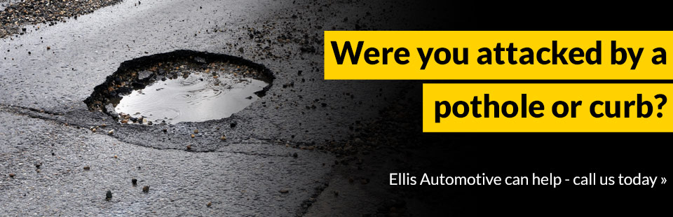 Were you attacked by a pothole or curb? Ellis Automotive can help - call us today!