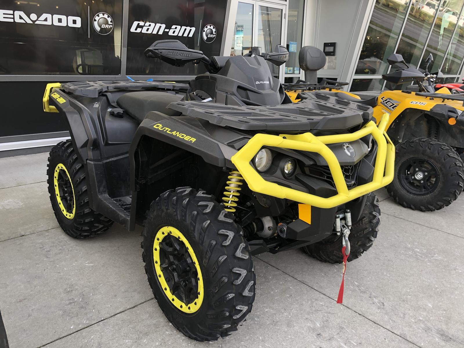used can-am outlander on lot