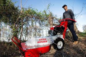Little-Wonder-Brush-Cutter-cuts-debris-along-fences-600x400