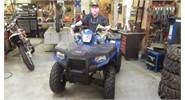 Roger is all smiles on his FUN new Polaris Sportsman 400 in Fire Blue!!