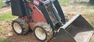 Toro equipment working in a field
