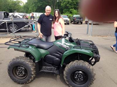 Steve with Leighann picking up her new 2014 Yamaha Grizzly 450