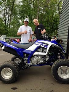 Steve with Tim picking up his new 2015 Yamaha Raptor 700R