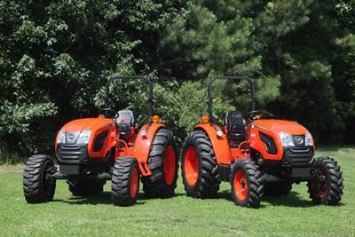 Kioti agricultural tractors side by side in field