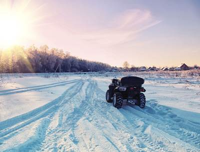 riding atv in winter in Groton, CT