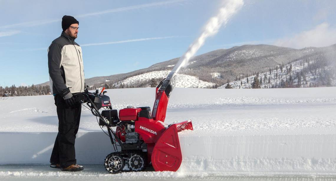 Man using a Single-Stage Honda Snowthrower