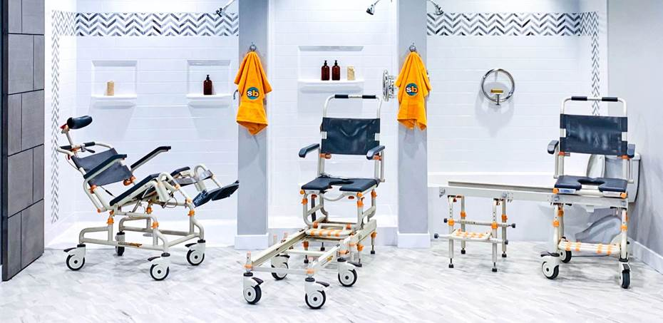 ShowerBuddy chairs in different positions in front of showers