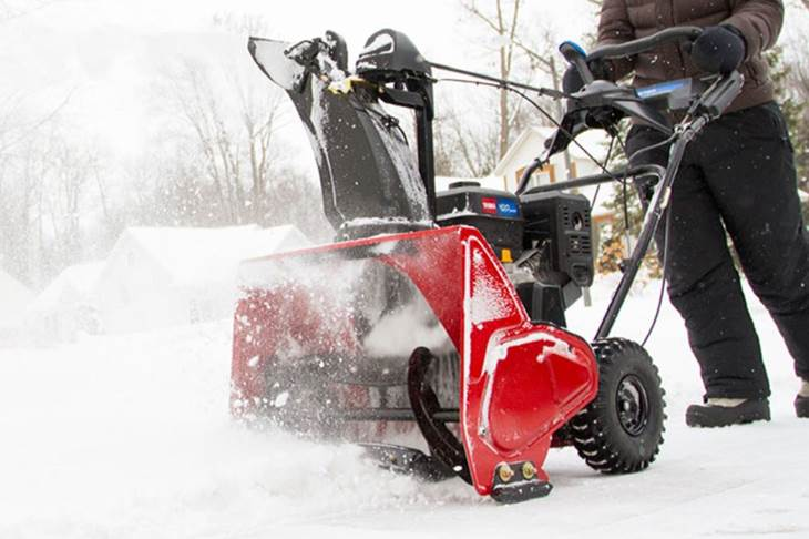 Man Pushing Toro Snowthrower