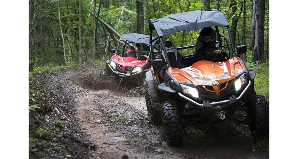 Two CFMOTO utvs riding in the mud