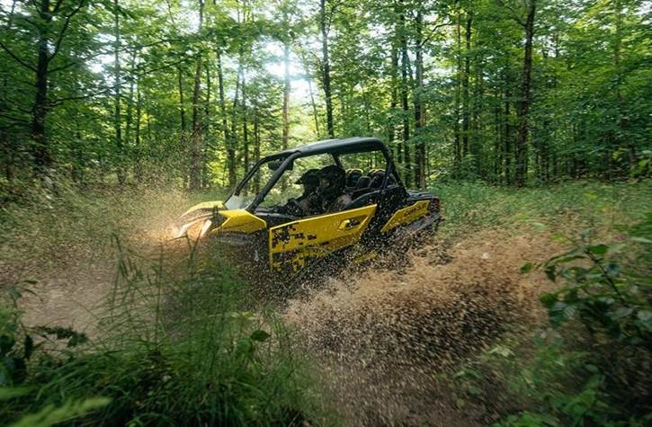 Can-Am Side by Side in mud