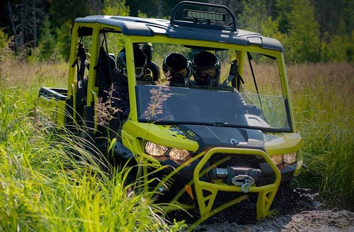 UTV in mud and grass