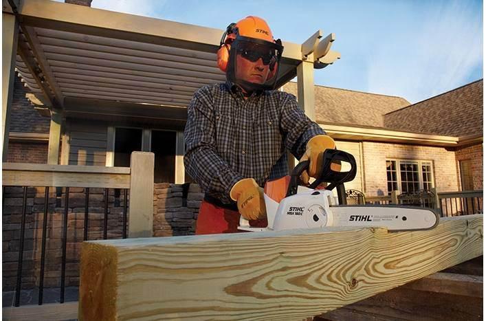 man using Stihl chainsaw