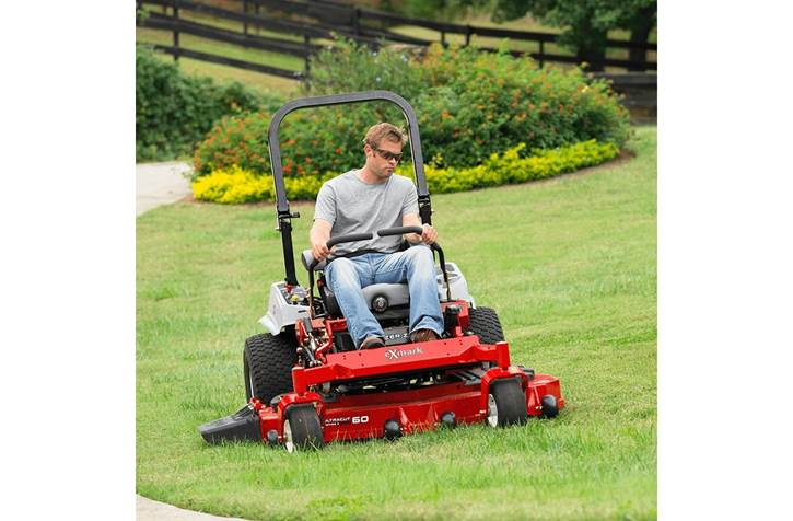 Man using ExMark zero-turn lawn mower