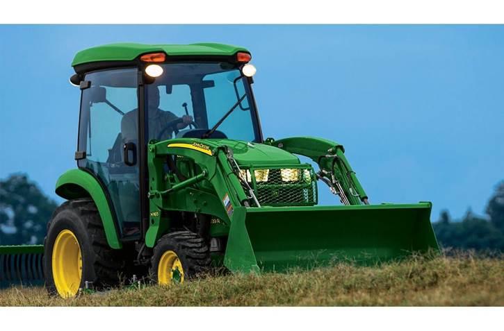 Man driving a John Deere tractor