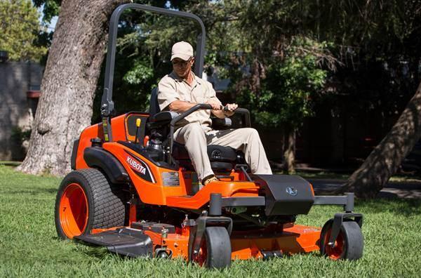 Man using Kubota ZD1500 Series zero-turn mower