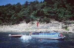 Pontoon, secluded cove, ski boat, and swimming