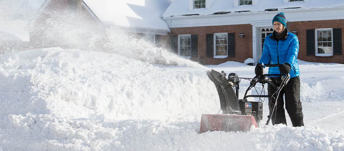 Lady using Toro Snowthrower