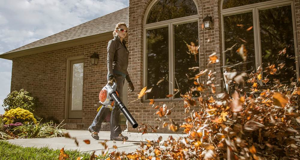 Woman Using STIHL Blower to Clear Leaves