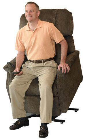 man lifted in tan seat lift chair
