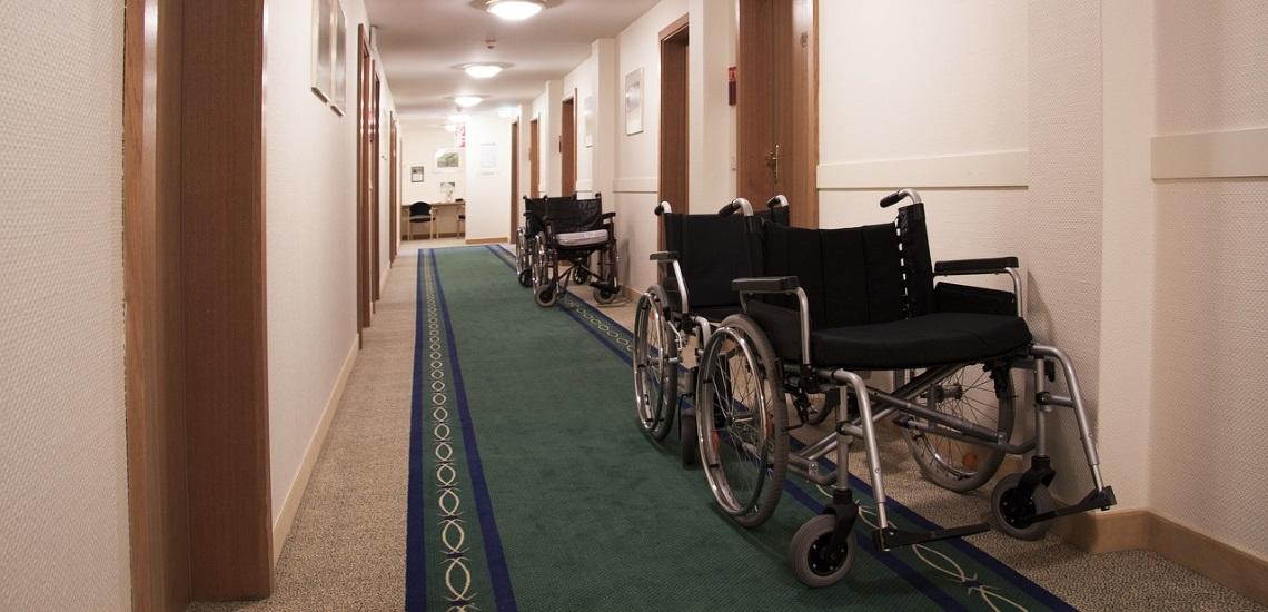 Several wheelchairs along a corridor