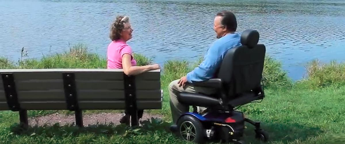 Man in Power Wheelchair at Park