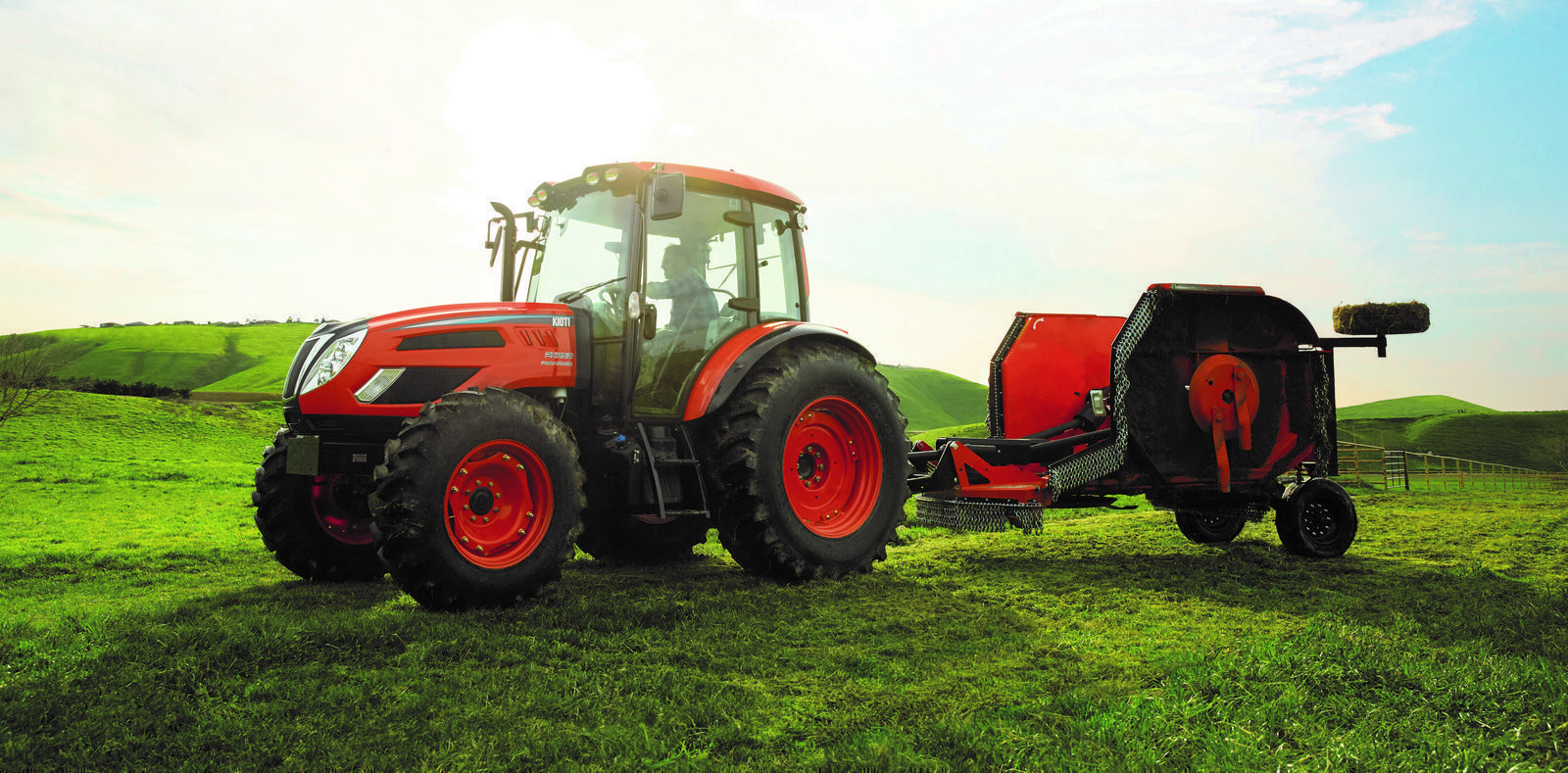 Kioti PX1152 Flexwing Agricultural Tractor in grassy field
