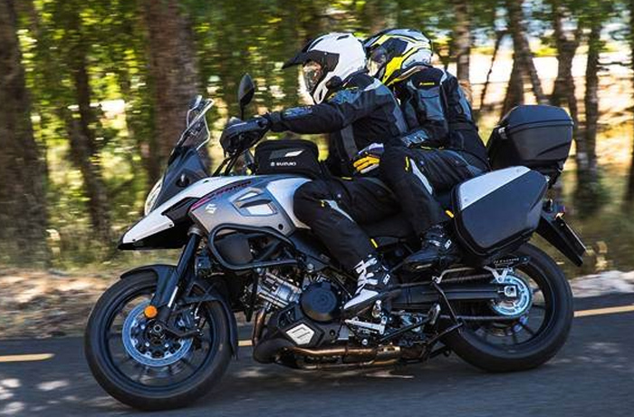 Two people riding a new Suzuki adventure street bike