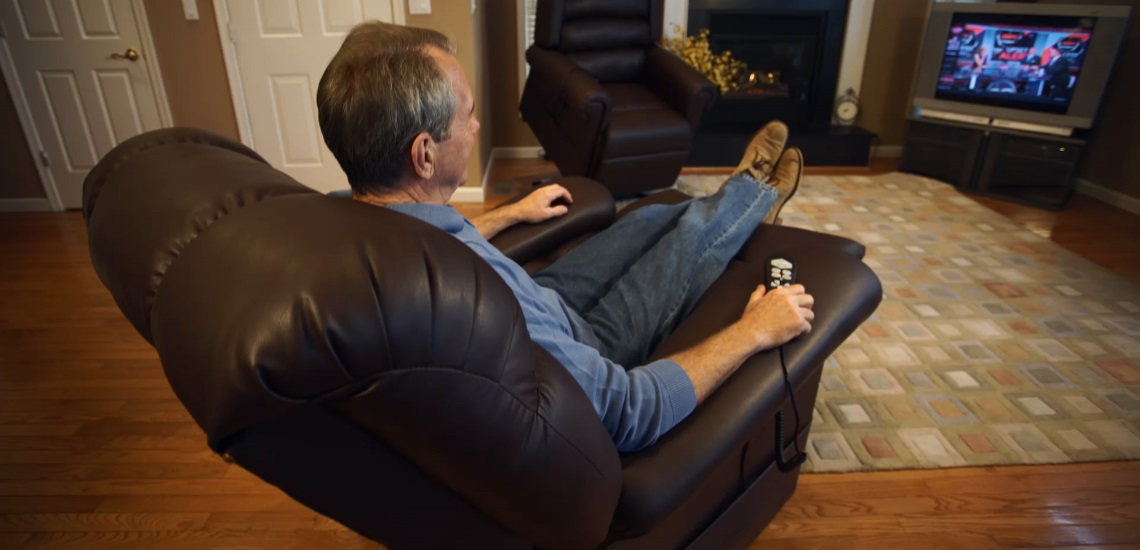 Man Reclined Watching TV On A Golden Technologies Lift Chair