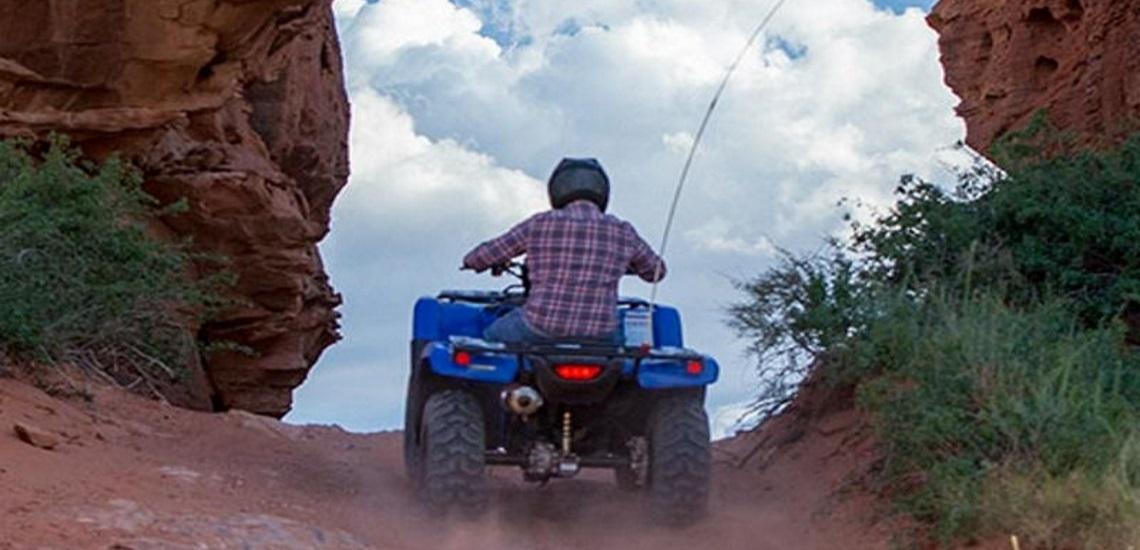 Man riding a 2020 Honda® FourTrax Foreman 4x4 ES EPS ATV up a dusty hill