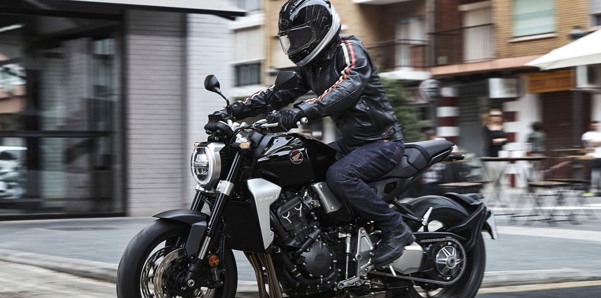 Man on Honda motorcycle