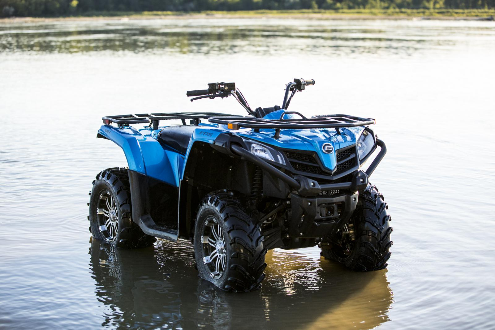 Blue CFMOTO ATV parked in shallow water