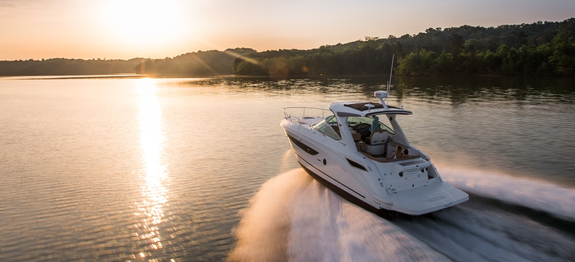Sea Ray Yacht on a lake when the sun goes down