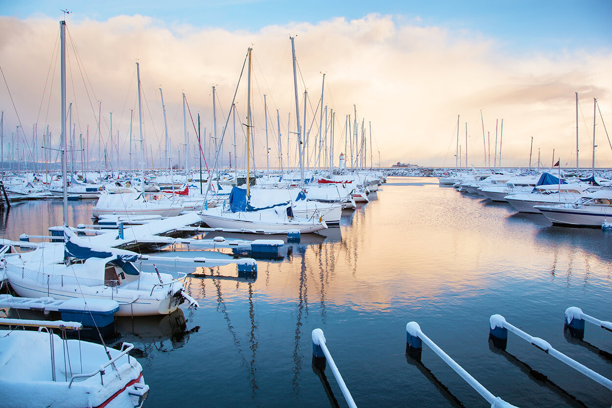 Boats in Snowy Marina