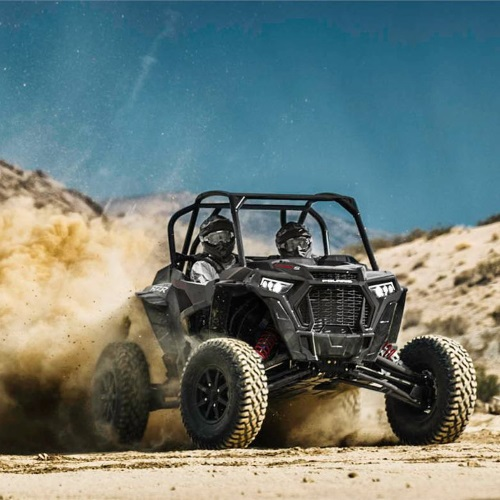 two bravest drivers in a 2019 Polaris Industries RZR XP® Turbo S touring the dunes