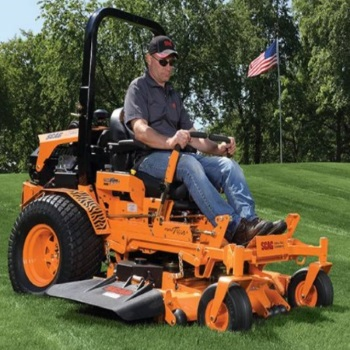 Scag zero turn mower on field with american flag in background